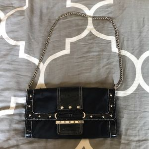 2268a0f10605 Women s Black Guess Studded Clutch on Poshmark
